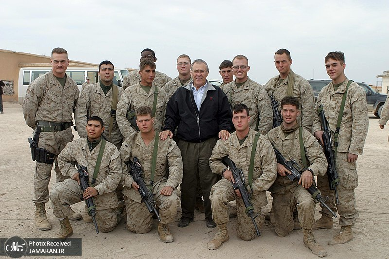 800px-US_Navy_041224-M-8096K-064_Secretary_of_Defense_(SECDEF)__Donald_Rumsfeld_takes_a_photo_with_some_Marines_at_Camp_Fallujah__Iraq2004
