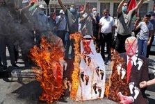 فلسطینی ها تصاویر بن زاید خائن و پرچم امارات را آتش زدند+تصاویر