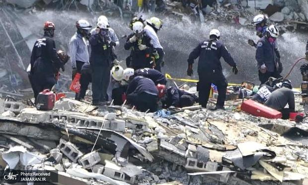 156 تن هنوز زیر آوار بجا مانده از فروریختن برج 12طبقه+ تصاویر